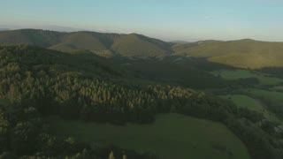 Aerial view of forest and grassland during sunny summer day. Slovakia, Zvolen.