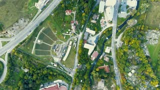 Aerial view of highway and town with houses, roads, nature, amphitheater and cementery, Banska Bystrica, Slovakia