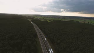 Aerial view of highway, forests and fields, windmills, village with houses, Netherlands