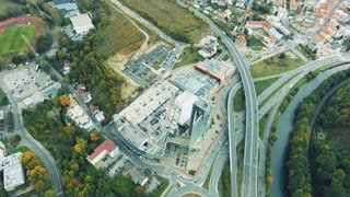 Aerial view of highway passing through the town, river, shopping center and football stadium. Banska Bystrica, Slovakia.