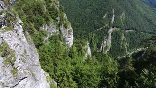 Aerial view of rocky hills with green trees, coniferous forest. Mala Fatra, Slovakia.