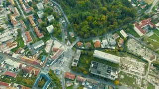 Aerial view of slovak town Banska Bystrica surrounded by green mountains.