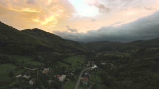 Aerial view of village surrounded by wood, sunset. Nova Bana, Slovakia.