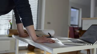 Architect working from home on computer. Unrecognizable man with laptop.