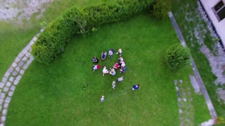 Children in summer camp playing together. Green summer nature.