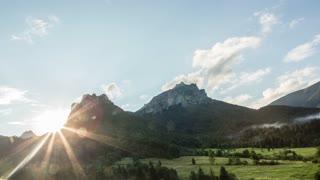 Coniferous forest, green grasslands and rocky hills, sunny evening. Mala Fatra, Slovakia .