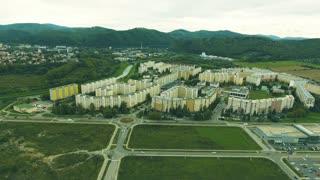 Highway crossing slovak town, aerial view. Banska Bystrica, Slovakia.