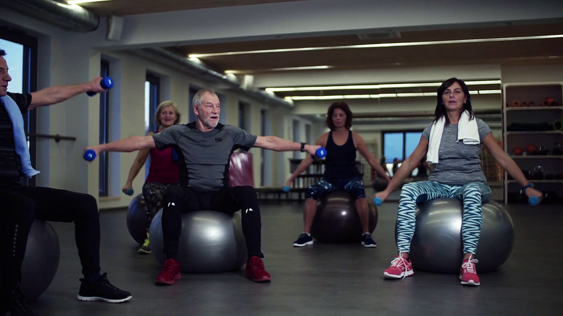 A Group Of Cheerful Seniors In Gym Doing Exercise With Dumbbells On Fit Balls Slow Motion Stock Video Footage Storyblocks