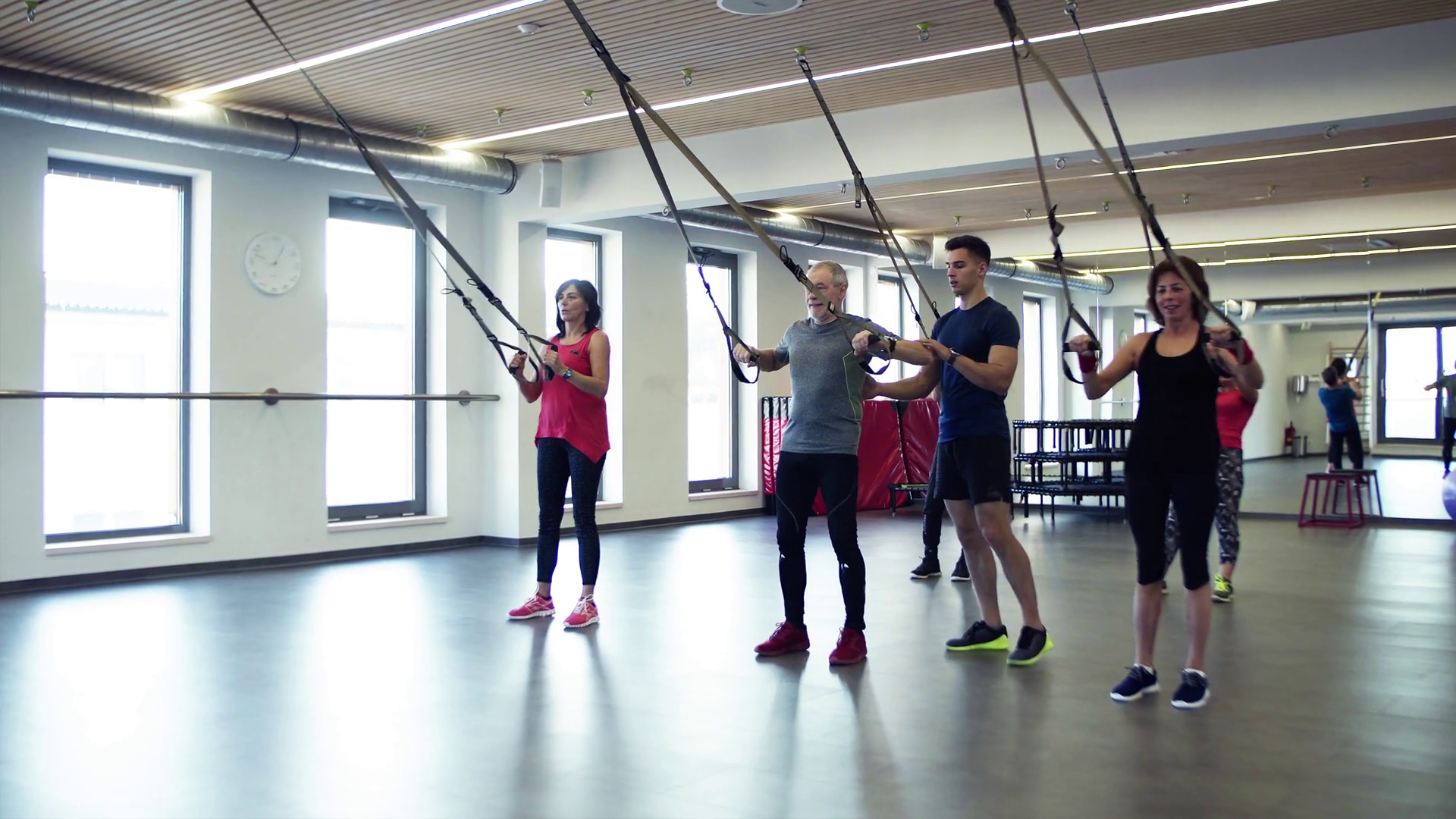 A Group Of Cheerful Seniors In Gym With A Young Personal Trainer Doing Exercise With Trx Stock Video Footage Storyblocks