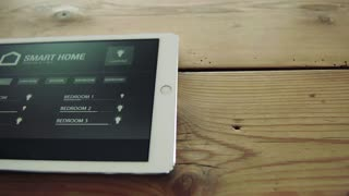 A tablet with smart home control system. Top view.