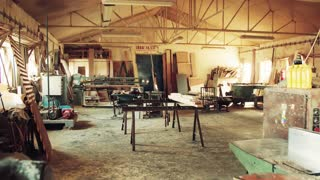 An empty interior of a big carpentry workshop.