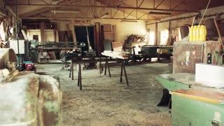 An empty interior of a big carpentry workshop.