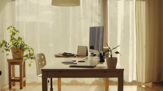 An interior of a home office. A desk, chair and a computer in a room. Slow motion
