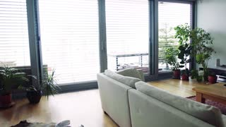 An interior of a modern spacious apartment. Smart home control system.