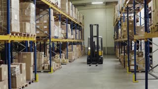 An interior of a warehouse with shelves and forklift