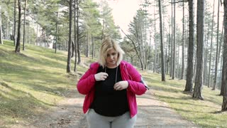 Attractive overweight woman getting ready for a run.