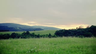 Beautiful rural landscape at dusk in summer. Slow motion.