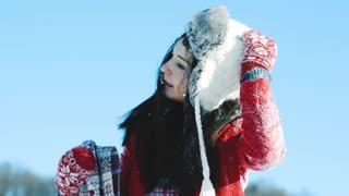 Beautiful young woman having fun in the snow.