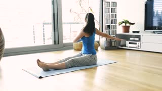 Subscription Library Beautiful Young Woman Working Out At Home In Her Living Room Doing Yoga Or Pilates