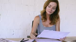 Businesswoman in her office working.