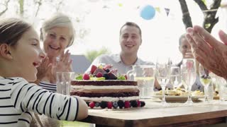 Family celebration outside in the backyard. Big garden party. Birthday party. Slow motion.