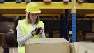Female warehouse worker with barcode scanner.
