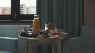 Food on a table in a hotel room.