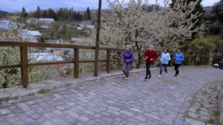 Group of seniors running outdoors in the old town.