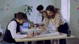 Group of young people working together in an office. Start-up business