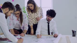 Group of young people working together in an office.