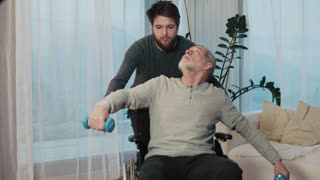 Hipster son and his senior father in wheelchair at home.