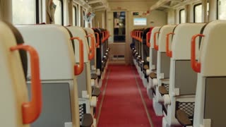Interior of a moving train with empty seats. Intercity train. Slow motion