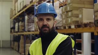 Portrait of a handsome worker in a warehouse