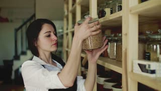 Portrait of a young woman shop assistant working in a zero-waste store or shop. Green living.