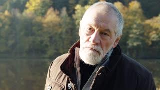 Senior man on a walk in autumn nature.