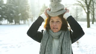 Senior woman in winter nature.
