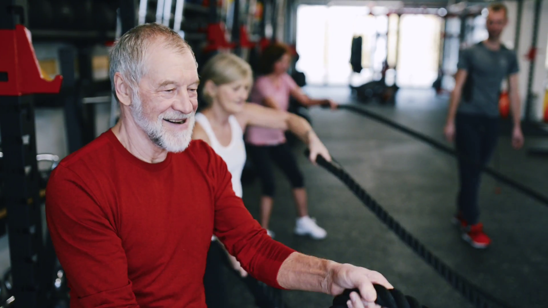Seniors In Gym With Personal Trainer Exercising With Battle Ropes Stock Video Footage Storyblocks