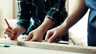 Small business of a young couple. Unrecognizable man and woman worker in the carpenter workroom