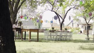 Table set for a garden party or celebration outside.