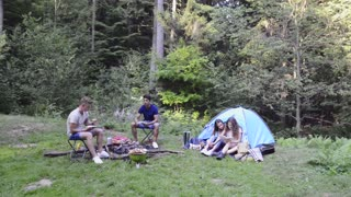 Teenagers camping in forest. Summer adventure.