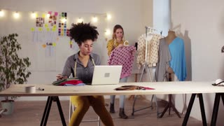 Young creative women with laptop and smartphone working in a studio, startup business.