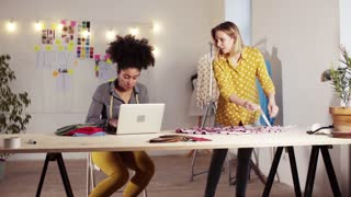 Young creative women with laptop working in a studio, startup business.
