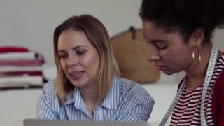 Young creative women working in a studio, startup business.