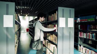 Young handsome male student studying in a library.