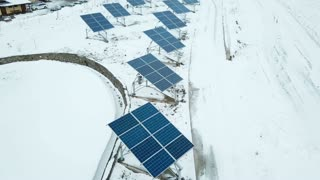 Alternative energy solar power plant in the winter. Solar power plant on the outskirts of the city.