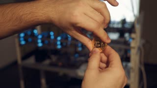Golden Bitcoin Coin. Bitcoin cryptocurrency. Business concept. Working graphic video cards for electronic currency