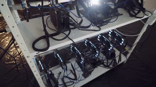 Installation of cryptocurrency mining using graphic cards. Concept of mining. Electronic virtual money