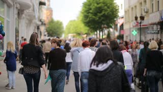 VINNISA, UKRAINE - MAY 2017: people crowd walking on busy street on daytime