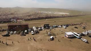 Aerial drone shot during naadam festival horse race finishing line Mongolia
