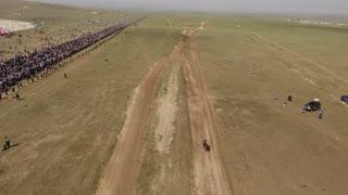 Aerial drone shot finishing line Naadam horse racing in mongolia